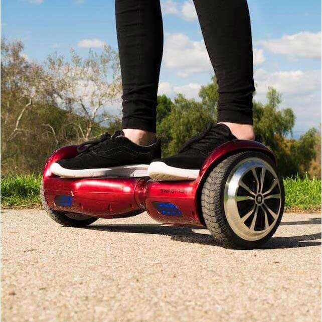 Woman riding red hoverboard in park