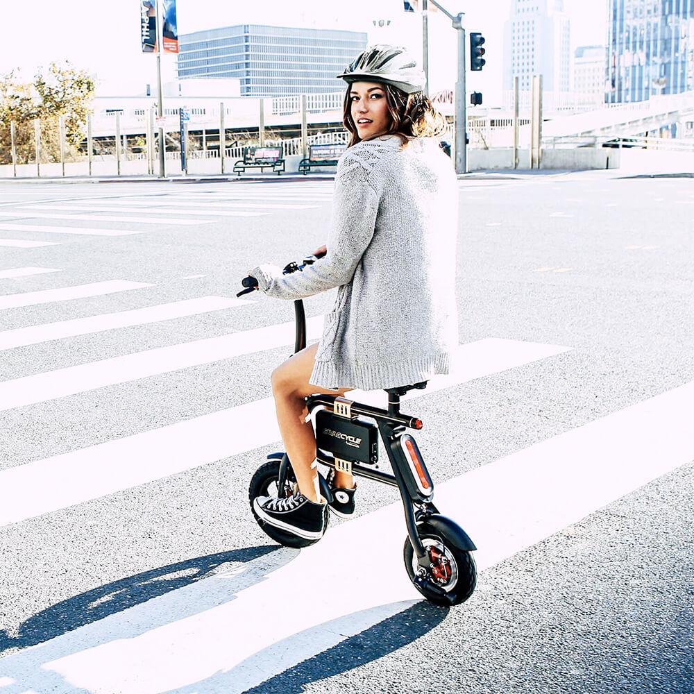 Girl riding the pedal-less e-Bike Swagcycle Classic