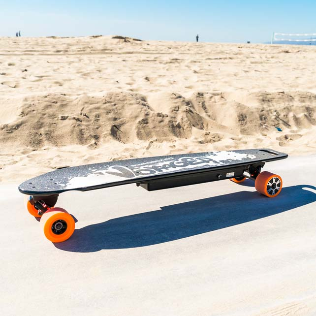 voyager electric longboard on beach