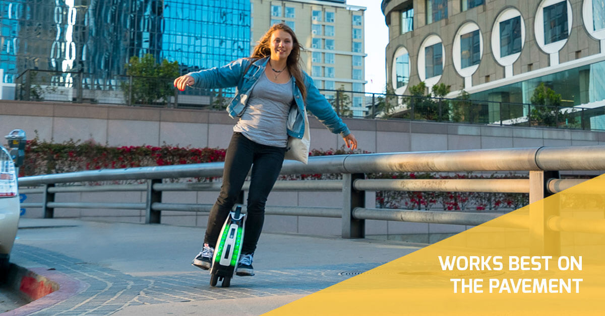 Girl with baby blue sweater on a swagtron electric unicycle