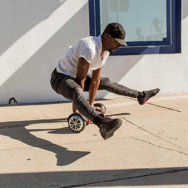 Man doing trick on black hoverboard