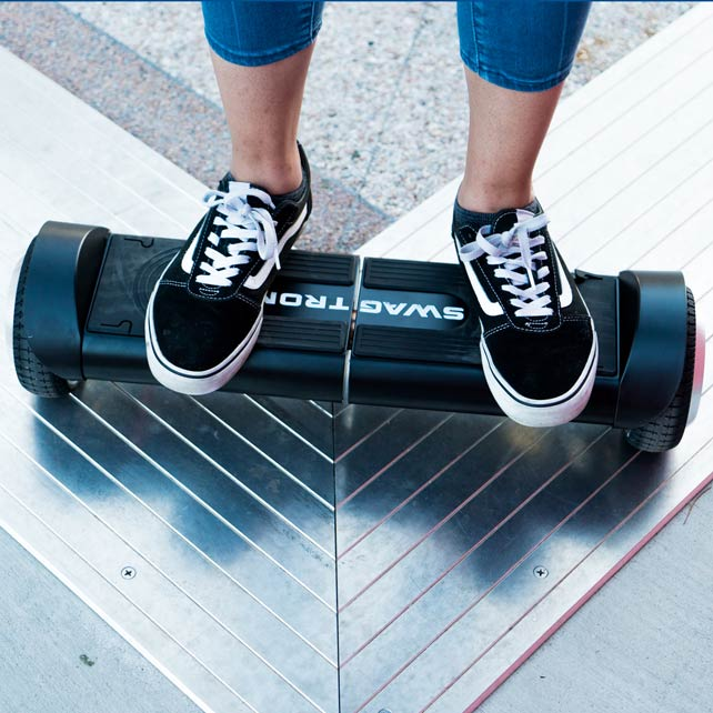 Woman with skater shoes on urban hoverboard