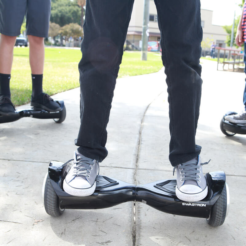 Kids riding in the park with their swagtron hoverboard T5 classic