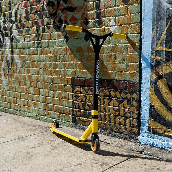 Swagtron black and yellow stunt scooter