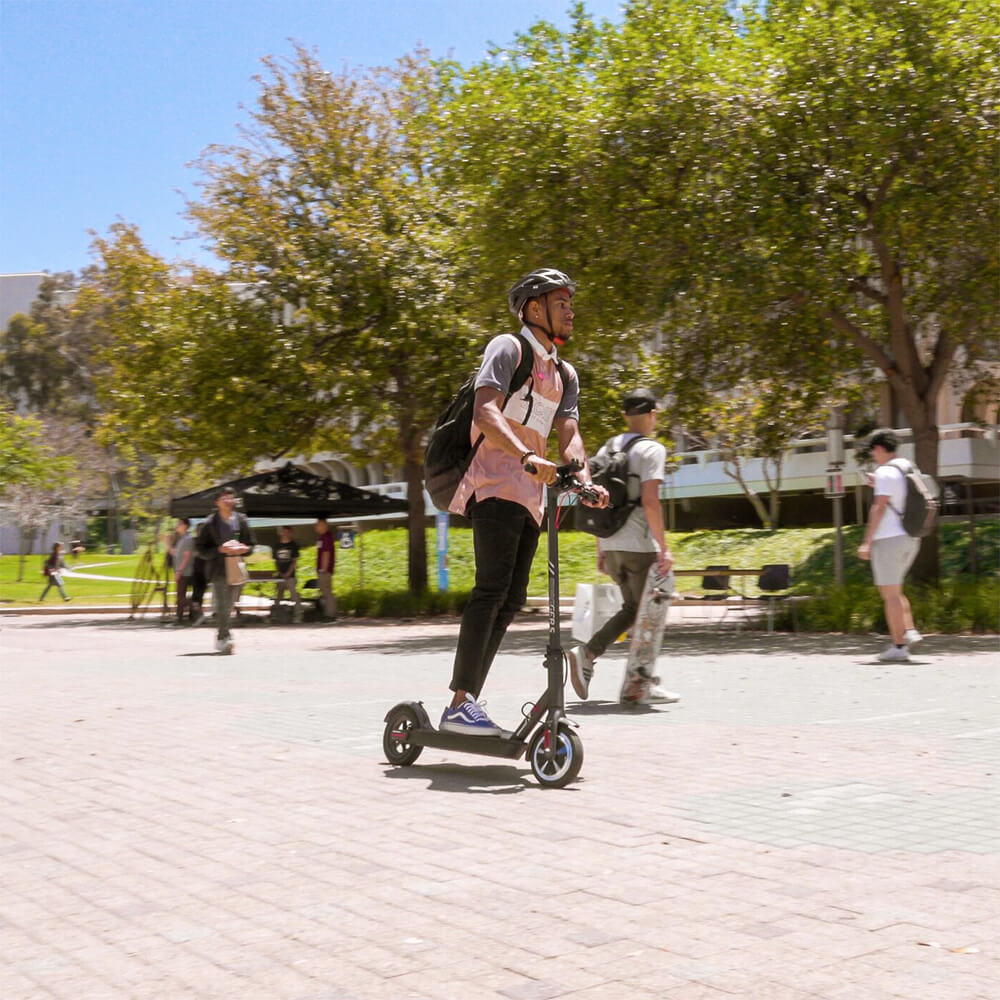Student riding his SG5 Electric Scooter on college campus on his way to class