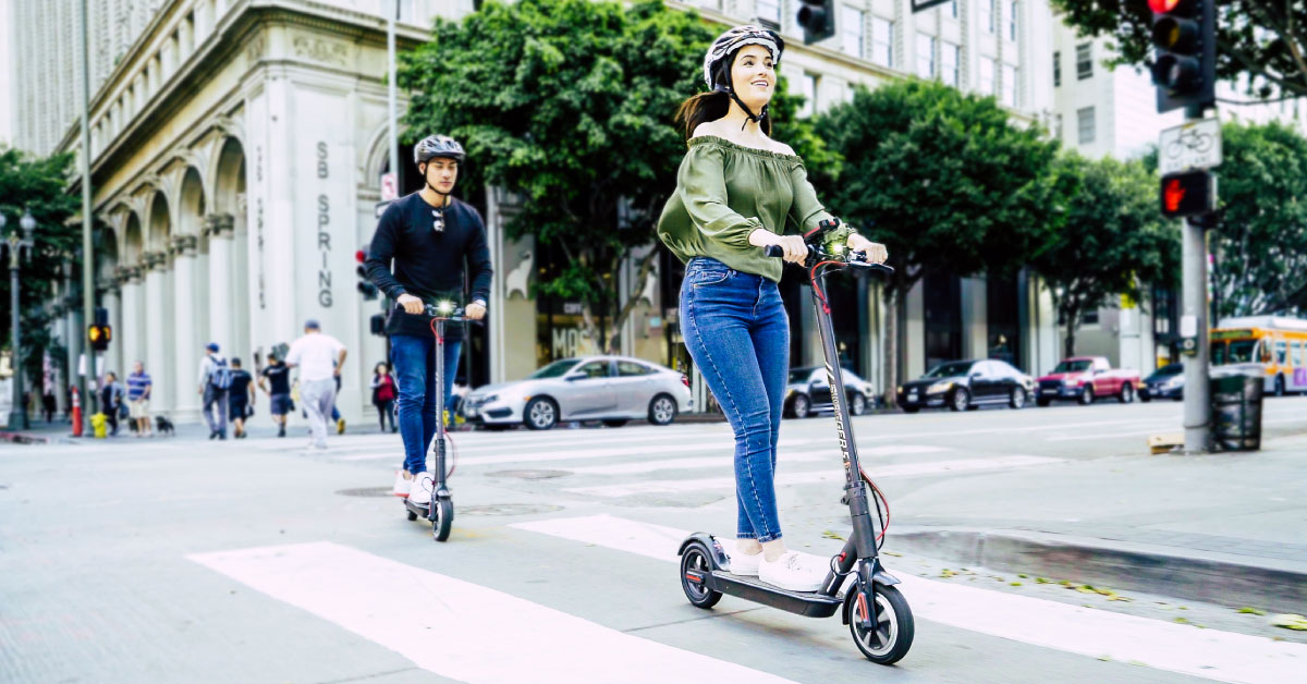 Couple riding the Swagger 5 Elite eScooter, the official electric scooter of the Chicago Cubs