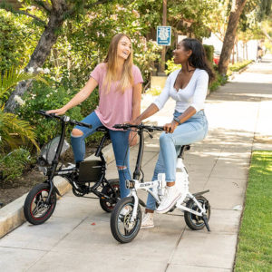 girls riding their SWAGTRON EB1 Commuter Electric Bike on their way to school
