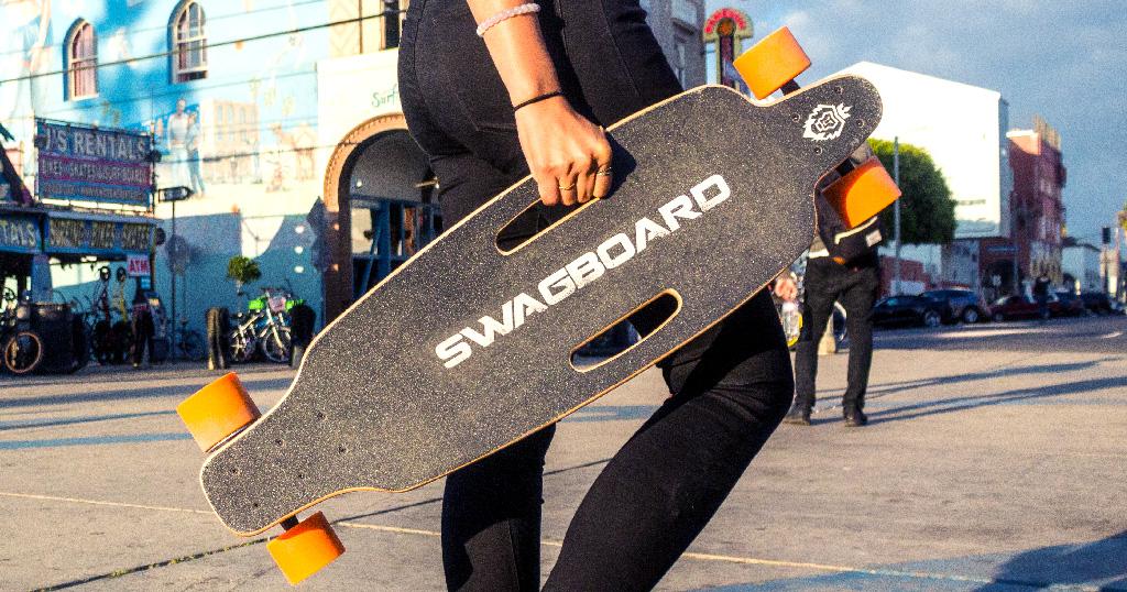 Holding a Swagskate NG1 eBoard