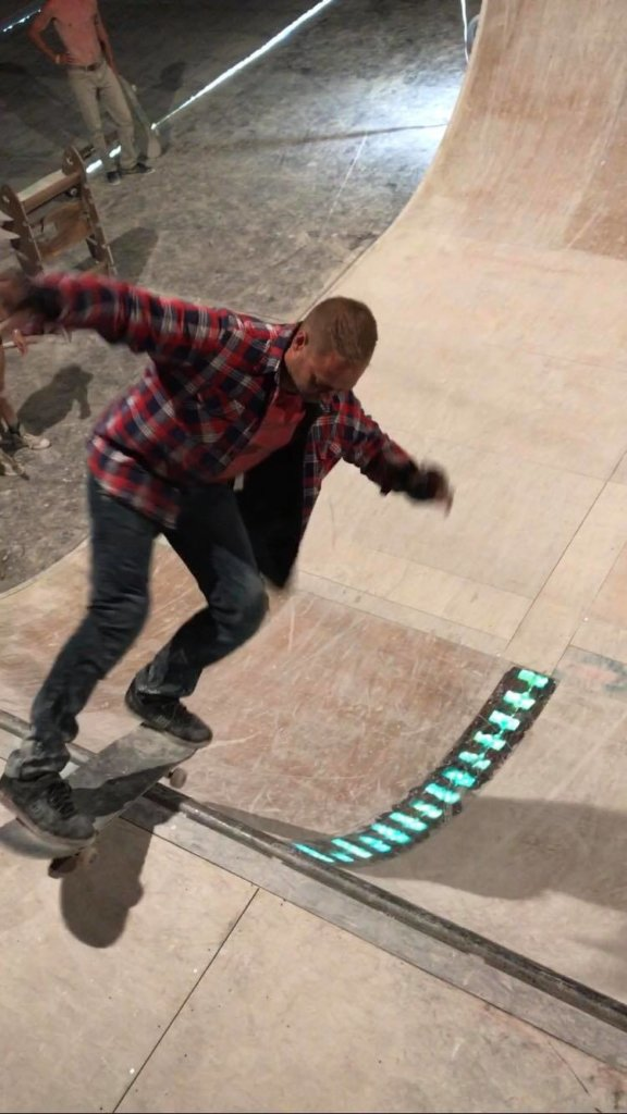 aaron skateboarding with pads