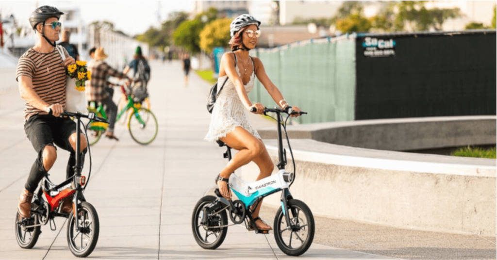 couple-riding-ebikes