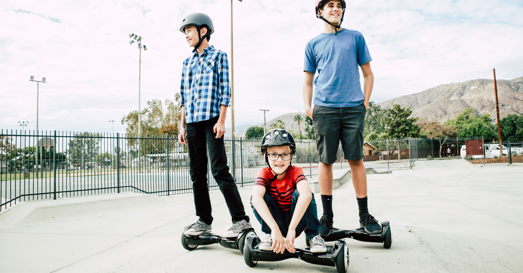 Hoverboard holiday: Three kids at various ages on their Swagboards.