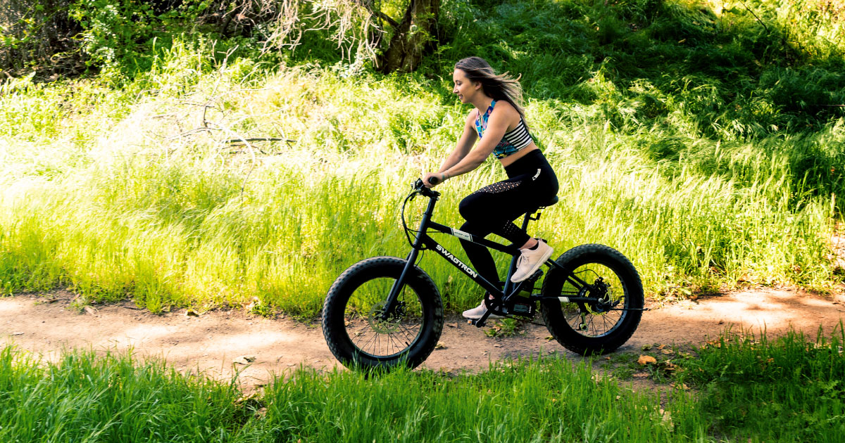 Smiling woman having fun on her Swagtron EB-6 Fat Tire Ebike