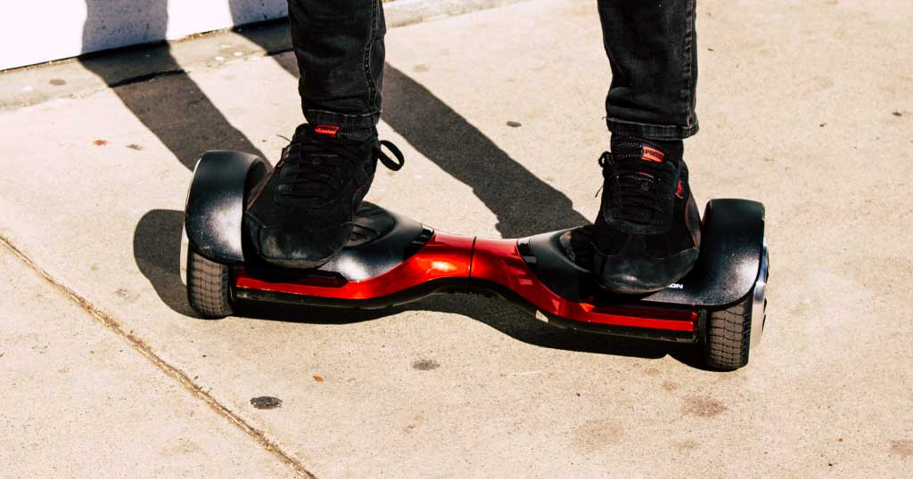 Close up of feet riding on Swagboard T580 hoverboard - holiday gifts