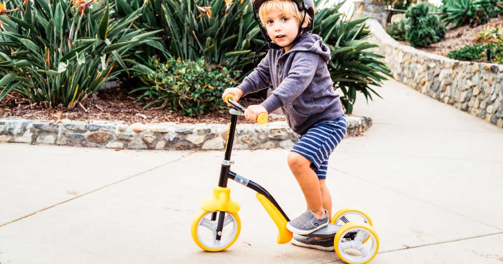 Young boy riding the K2 Toddler 2-in-1 scooter