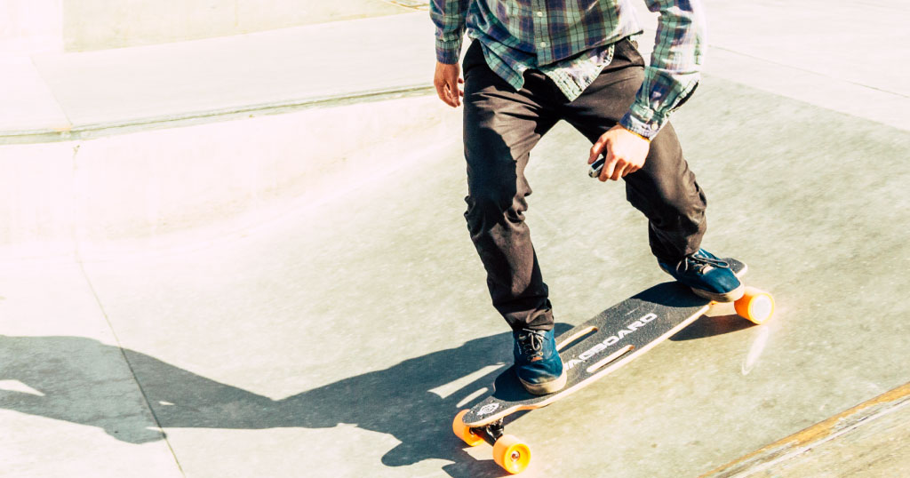 Guy riding Swagskate NG1 Electric Skateboard