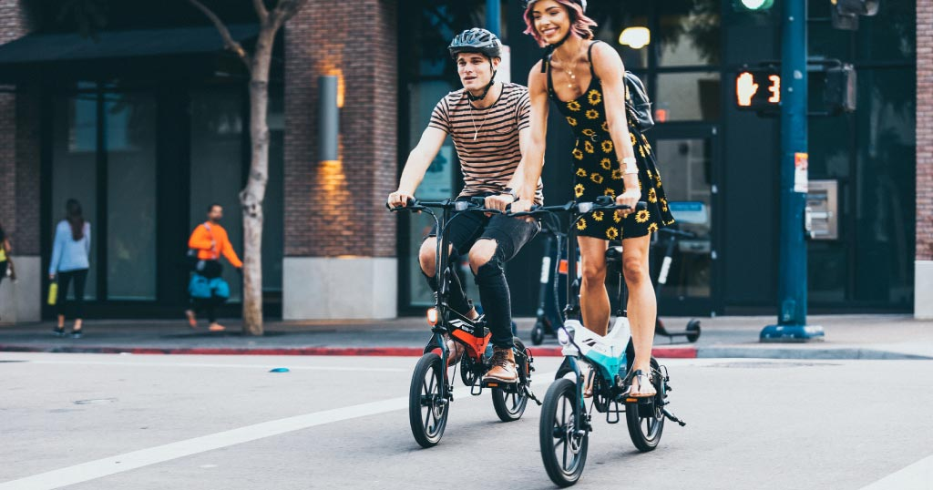 Couple riding EB7 Elite electric bike