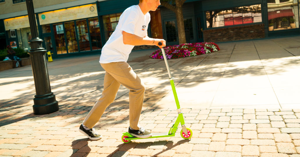 Teen boy riding a K1 kick scooter
