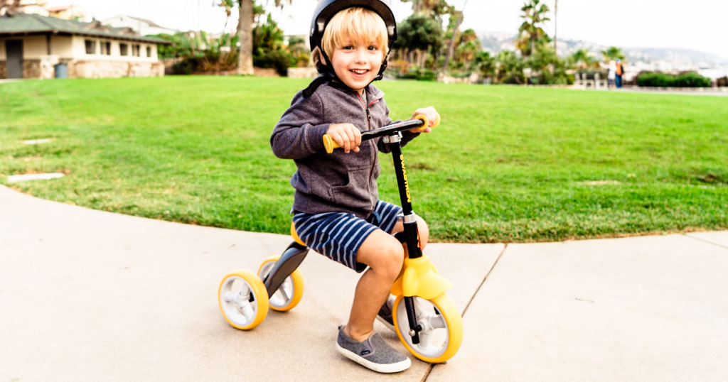 Boy riding a K2 toddler scooter 2-in-1