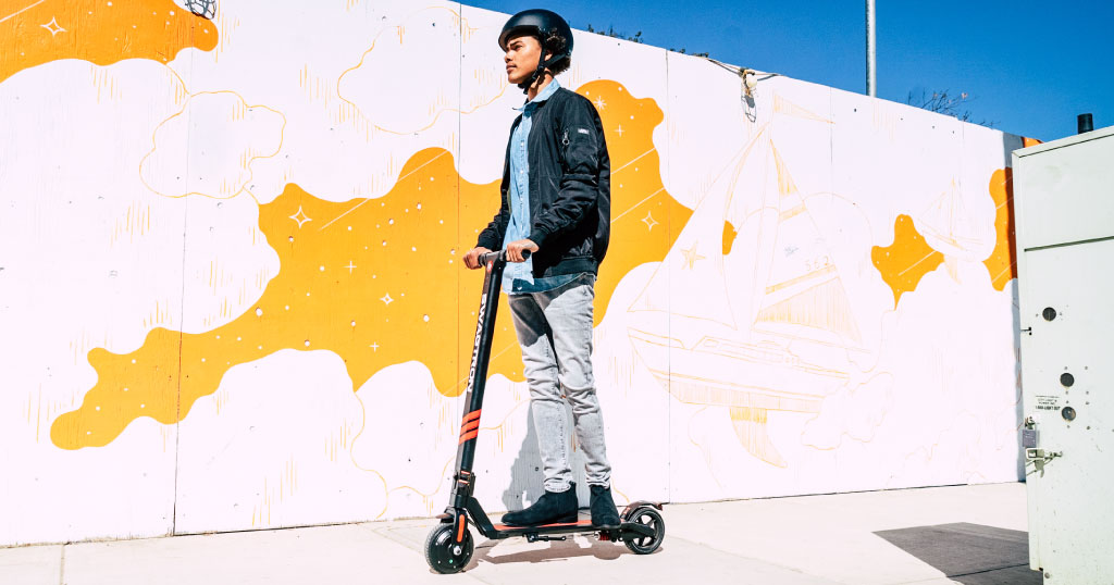 Guy riding a Swagger 3 Pro electric scooter