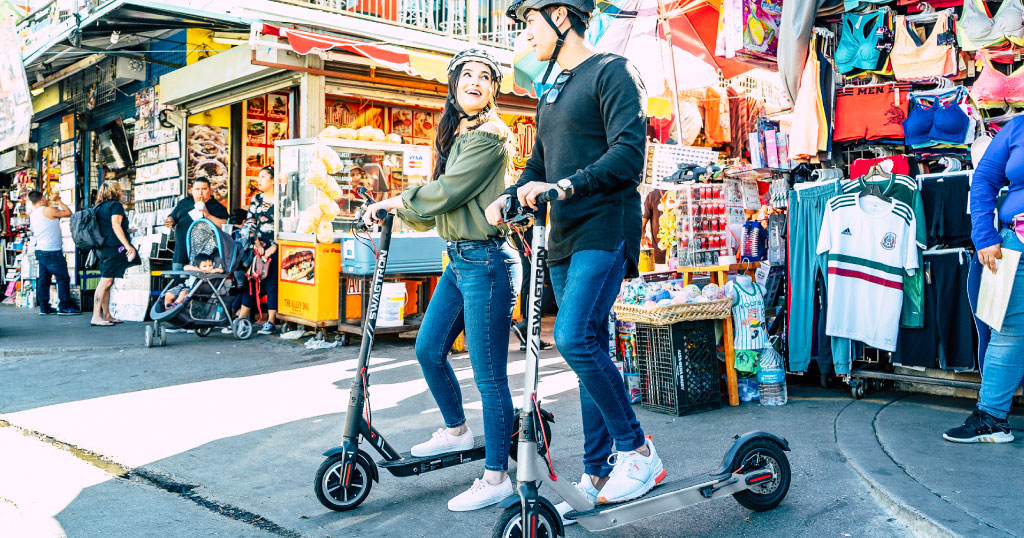 Young couple riding their Swagger 5 Elite Pro and Elite Pro Silver Edition eScooters