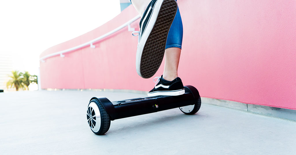 Hoverboard Holiday Guide: Close-up of teen girl riding Duro T6