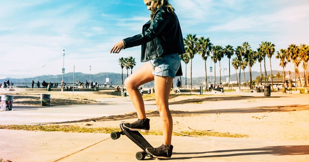 Electric skateboard gift ideas from Swagtron - Girl riding Spectra Mini