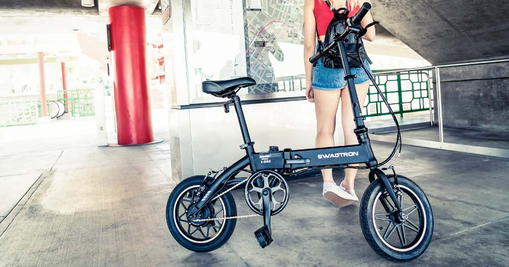Young lady standing behind an EB5 Pro Electric Bike