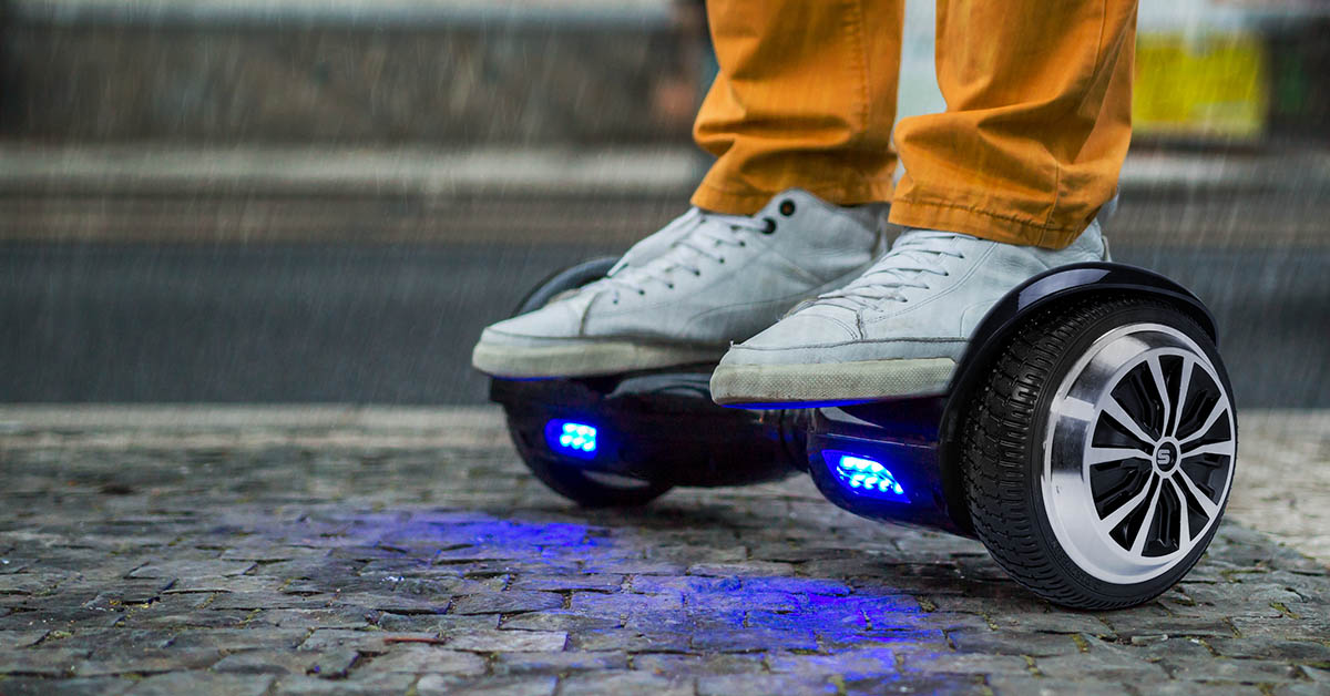 Close-up of a hoverboard being ridden in the rain (not recommended)