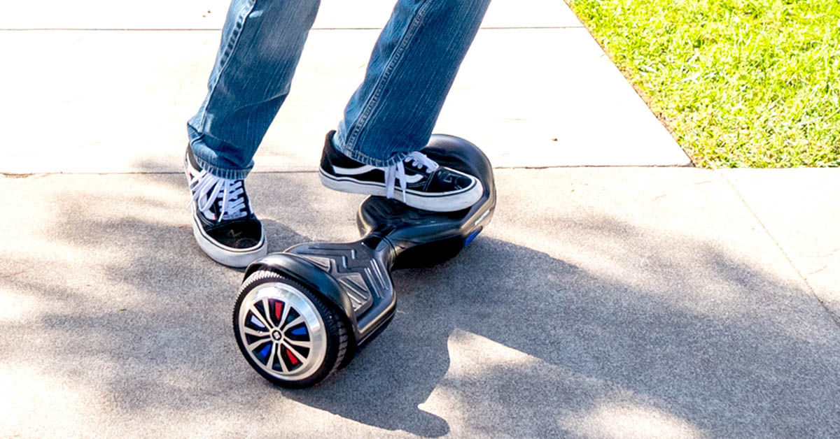 Close-up of kid stepping back off a hoverboard