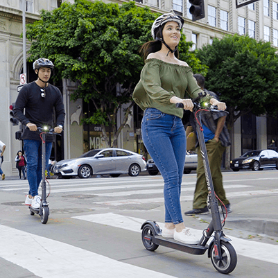 Couple riding scooters