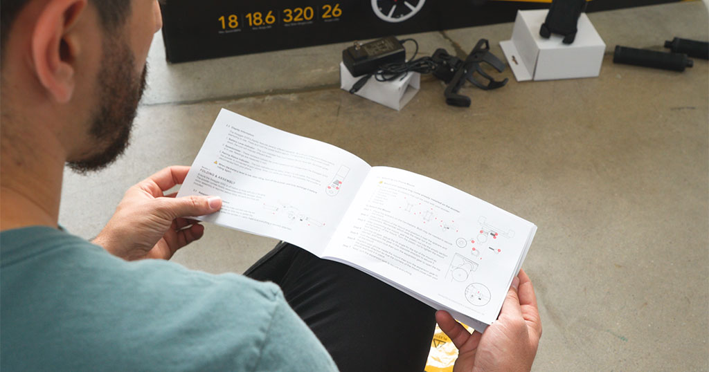 Guy reading the manual to get the right tire inflation info for his Swagger 5.