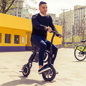 Man riding his electric pedal less bike by swagtron; the Swagcycle Pro