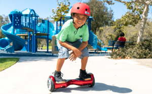 Kid riding his self-balancing hoverboard at the park