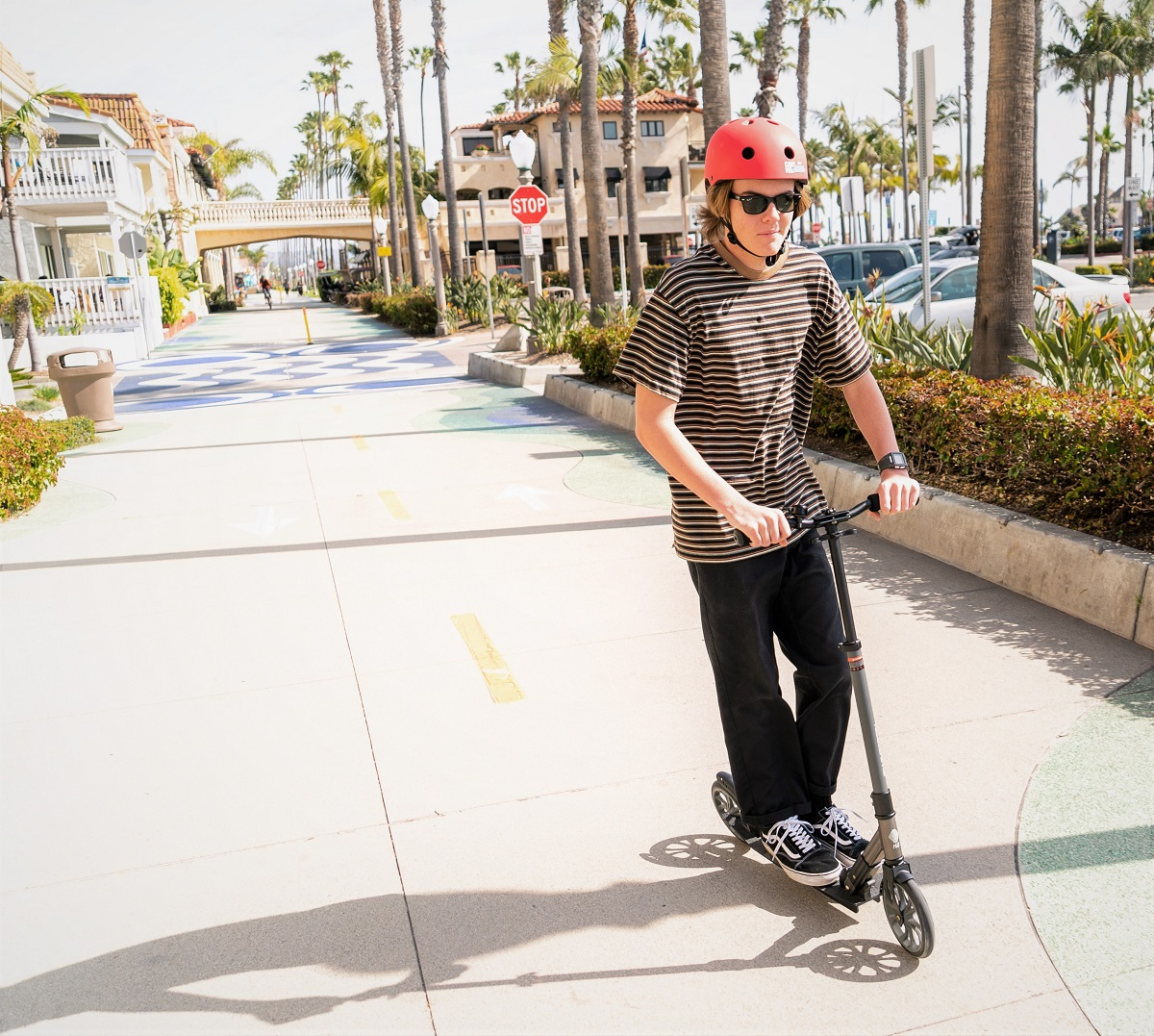 kid wearing a helmet and riding the K8 Titan kick scooter