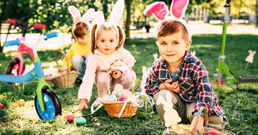 Kids on an Easter Egg Hunt, surrounded by Swagtron rideables