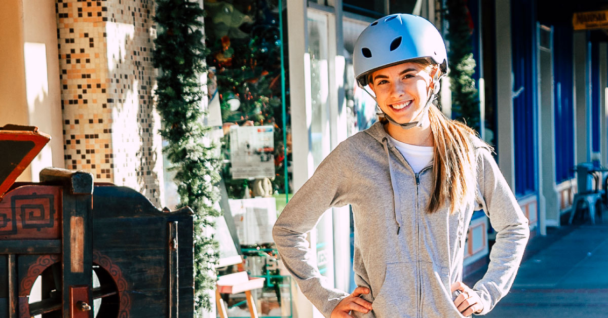 Smiling girl wearing a helmet