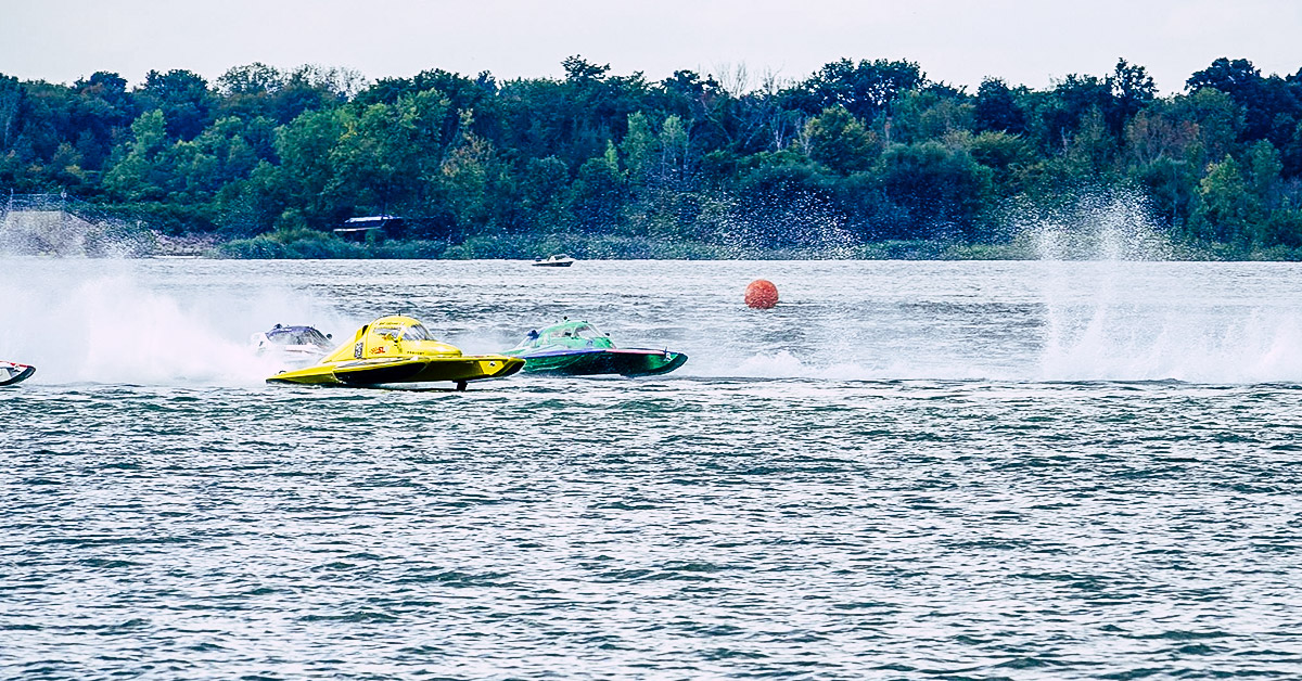 Two hydropanes racing in the water for a H8 Cancer charity race