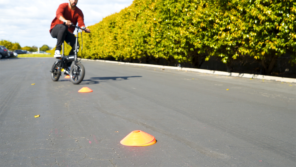 Man wearing a helmet riding on even pavement on his EB5 Pro