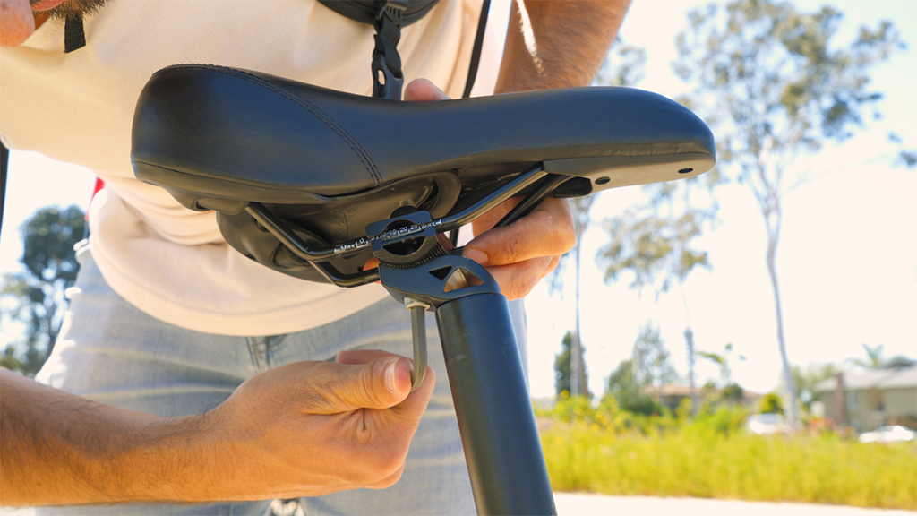 Close-up of guy using a hex key to tighten the seat of his EB5 Pro