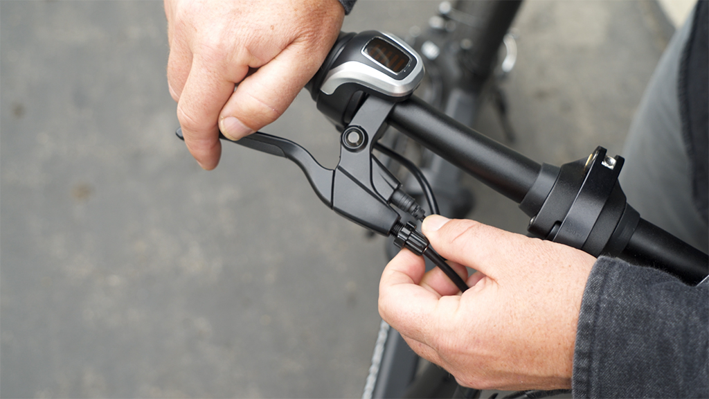 Close-up of guy tighening the handbrake of his EB5 Pro eBike