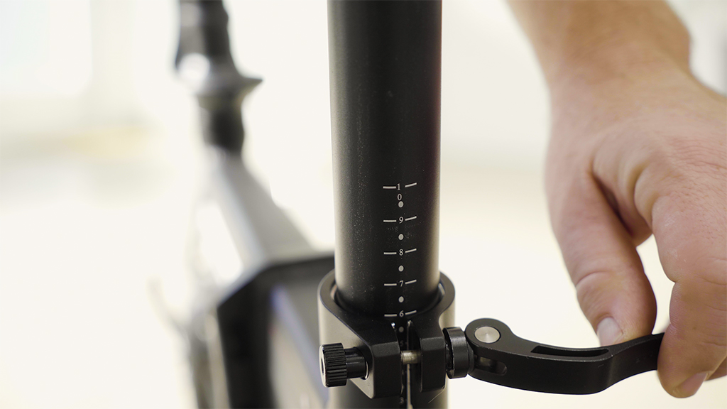 Close-up of the EB5 Pro seat post clamp and safety markings