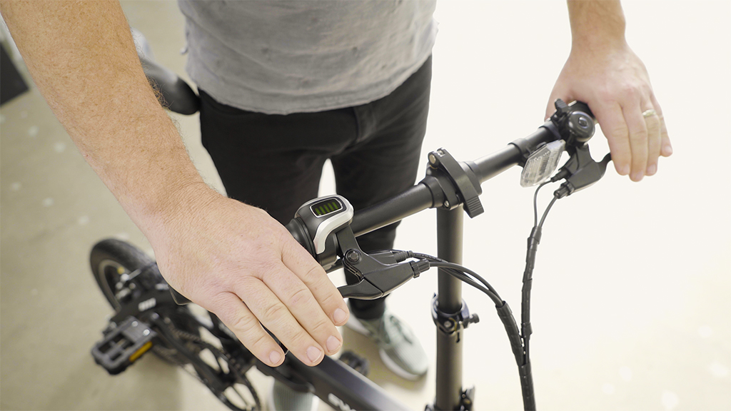 Close-up of guy squeezing hand brakes of his EB5 Pro.
