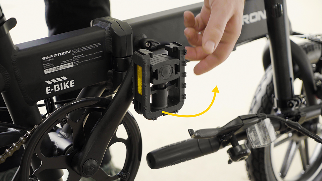 Close-up of guy folding up the EB5 Pro eBike pedals