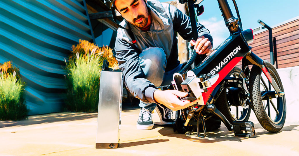 Close-up of man swapping the battery on his EB7 Elite eBike
