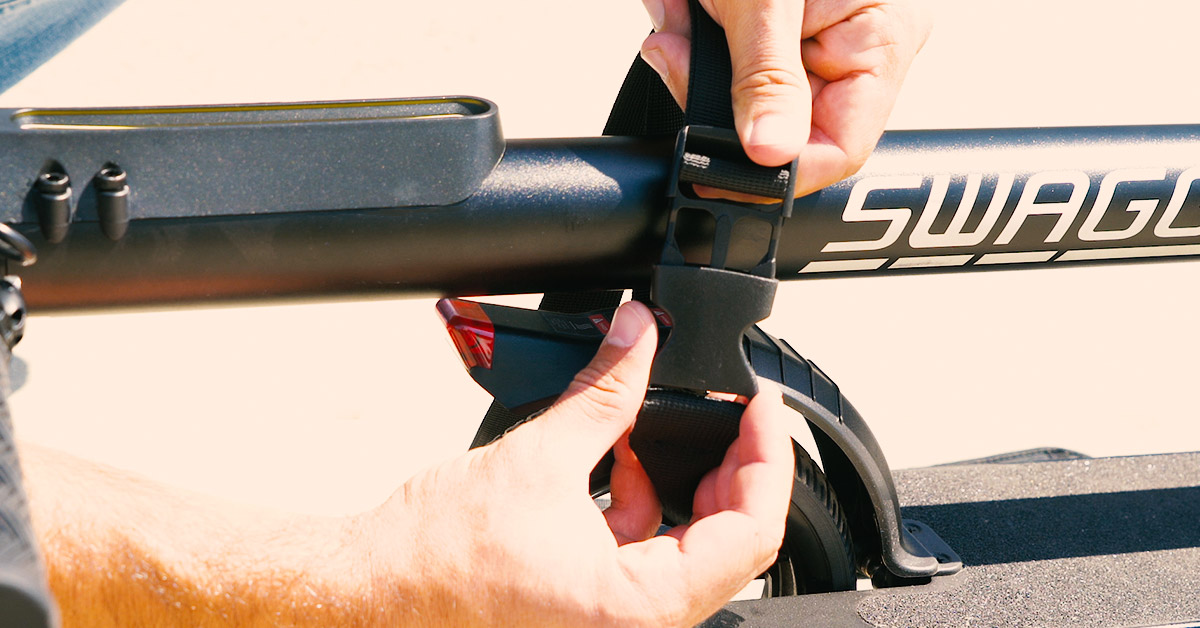 Close-up of guy latching the Swagstrap around the front of the Swagger 2 Classic