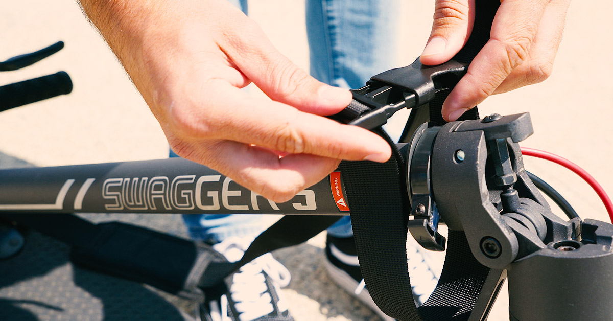 Close-up of guy latching the Swagstrap around the front of the Swagger 5 Elite