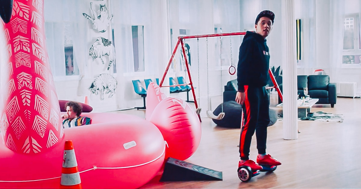 Scene from Someone Great: Mikey (played by Jaboukie Young-White) rides on a T580 Vibe hoverboard