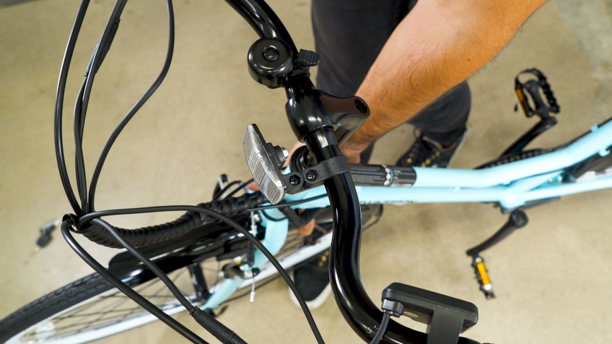Clsoe up of man aligning the handlebar to the front wheel