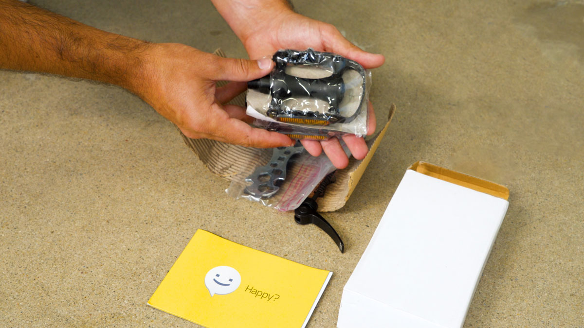 Man gathering tools from the EB9 package