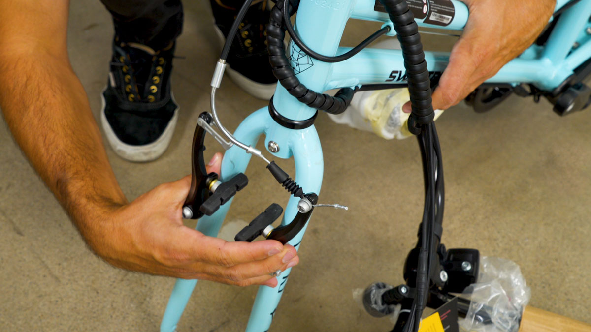 Man rotating the front fork before EB9 assembly